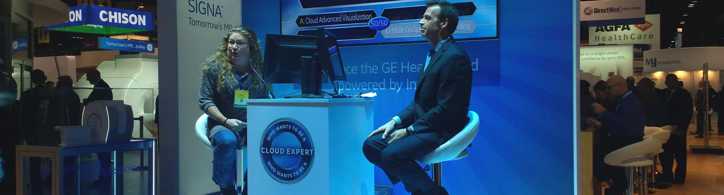 Image: A woman playing 'Who Wants to be a Cloud Expert' at a trade show.